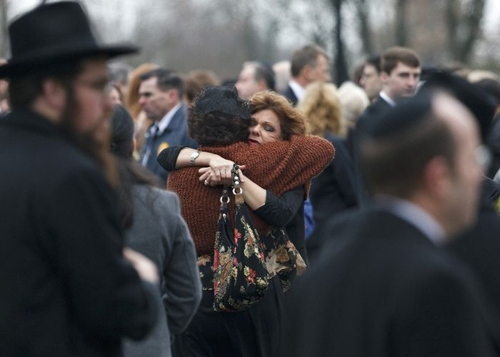 Mourners gather for first funerals, Photo 1 of 12
