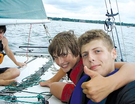 Madison's Chris Muckle (right), with volunteer instructor Andrew Hook (left), is passing on the sailing lessons he learned at the Madison Surf Club now as an instructor.