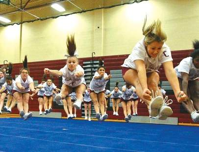 Alyssa Casamento (left) and Felishia LaPointe (right) are athletes at North Haven High School who compete in cheerleading, something which is considered a sport by many, but is classified as an activity by the CIAC.