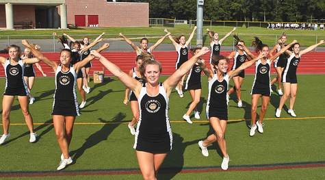 Lindsay Buckley (left), Tiffany Kaufmann (middle), and Christine Donat (right) are athletes at Hand High School who compete in cheerleading, something which is considered a sport by many, but is classified as an activity by the CIAC.