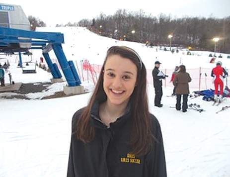 Freshman Anna Baker has made an instant splash on the Tigers' ski team, improving her placing in each race while building bonds on the slopes.