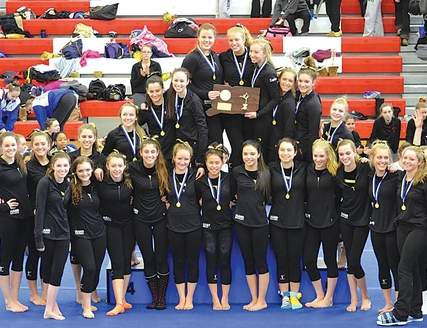 Hand gymnastics proudly stands with its second straight Class M state championship trophy on March 1 at Pomperaug, the program's 15th state title overall. With their score of 142.275, the Tigers additionally won each of the four events as a squad.