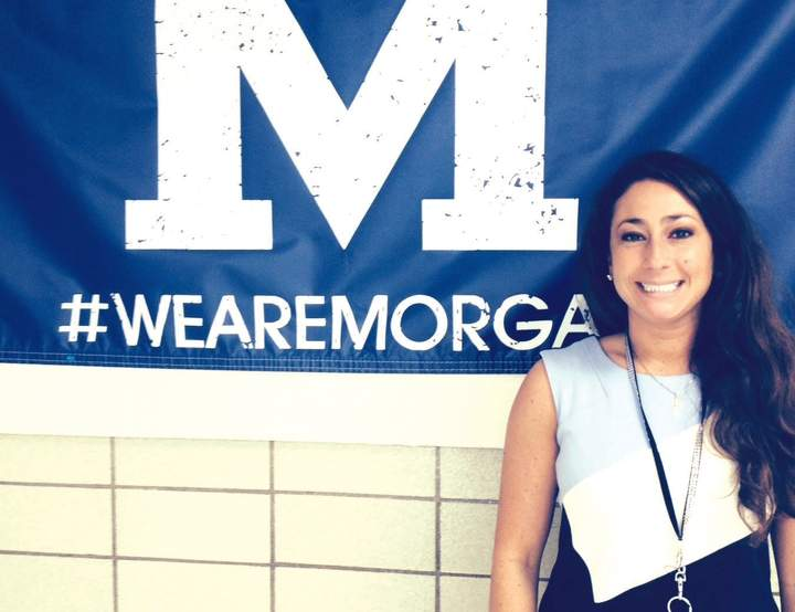 Morgan guidance counselor Joni Capobianco is bringing her vast cheerleading experience in addition to connection with students to the mat as the new head coach of the Huskies' cheerleading squad.