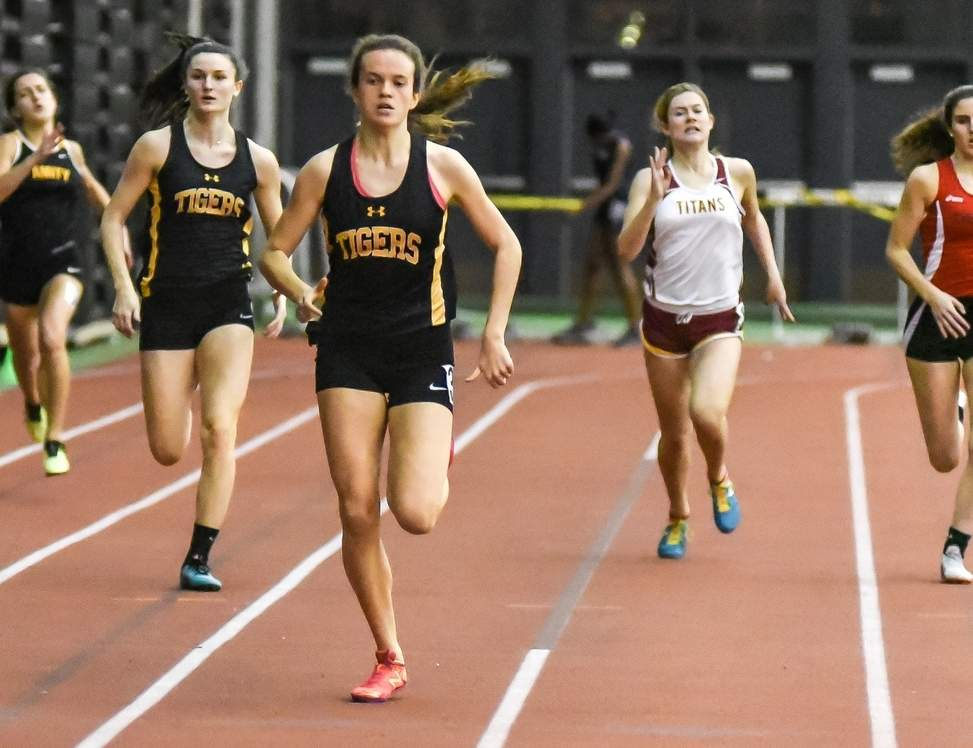 Caroline O'Neil won both the 55 and 300 titles and ran on a victorious 4x200 relay for Hand girls' indoor track at the SCC East Sectional Championship. Pictured on the left is teammate Gabrielle Harmon.