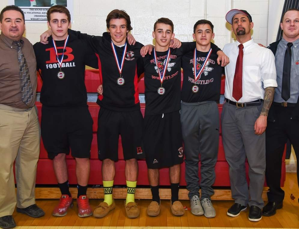 The Branford wrestling team finished sixth at the SCC Championship and saw four athletes earn second-place medals. Pictured are Head Coach Chris Bonagiuso with athletes Jackson Seward, Zach Cash, Noah Pantani, and Willie Gambardella, plus assistant coaches Jesse Hurlburt and Dan DiBisceglie.