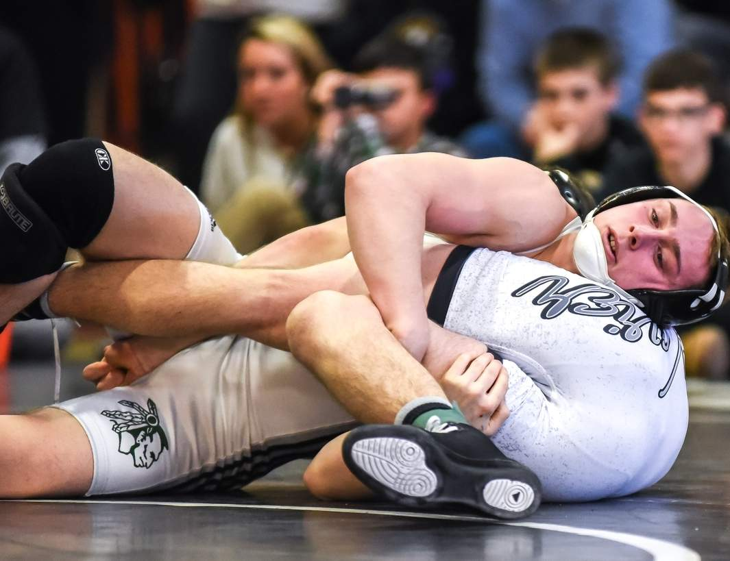 Drew Tischer and three of his Guilford wrestling teammates competed at the State Open Championship at the Floyd Little Athletic Center in New Haven last week