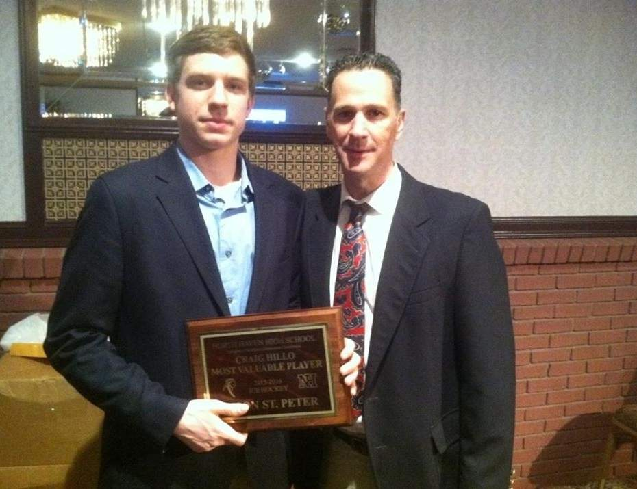 Senior captain Jason St. Peter earned a host of honors for his performance on the ice this season, including the Indians' Most Valuable Player Award. St. Peter is pictured with North Haven Head Coach Mike Silengo.