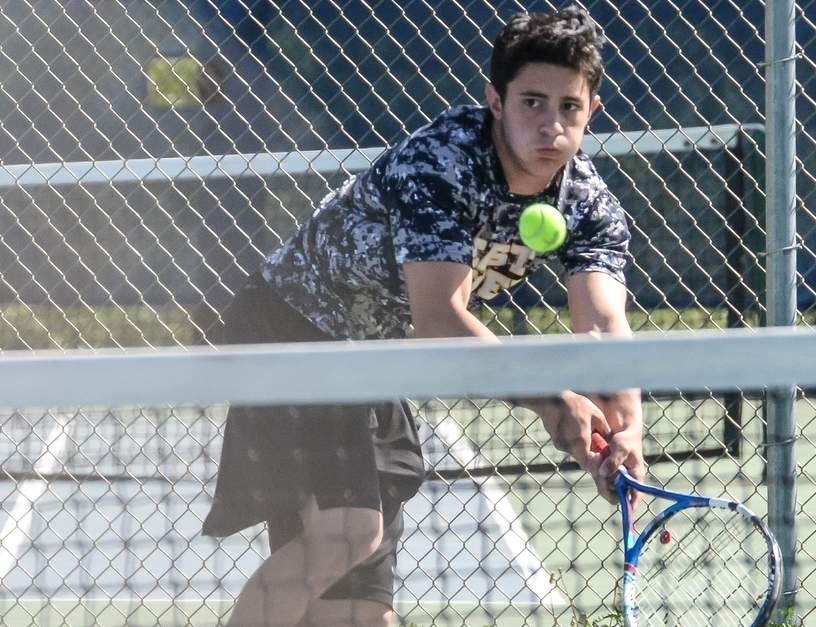 Rob Proto controlled his match at No. 2 singles when East Haven boys' tennis defeated Foran in the Yellowjackets' first home match this season that took place at Silver Sands Beach Club.  Photo by Kelley Fryer/The Courier