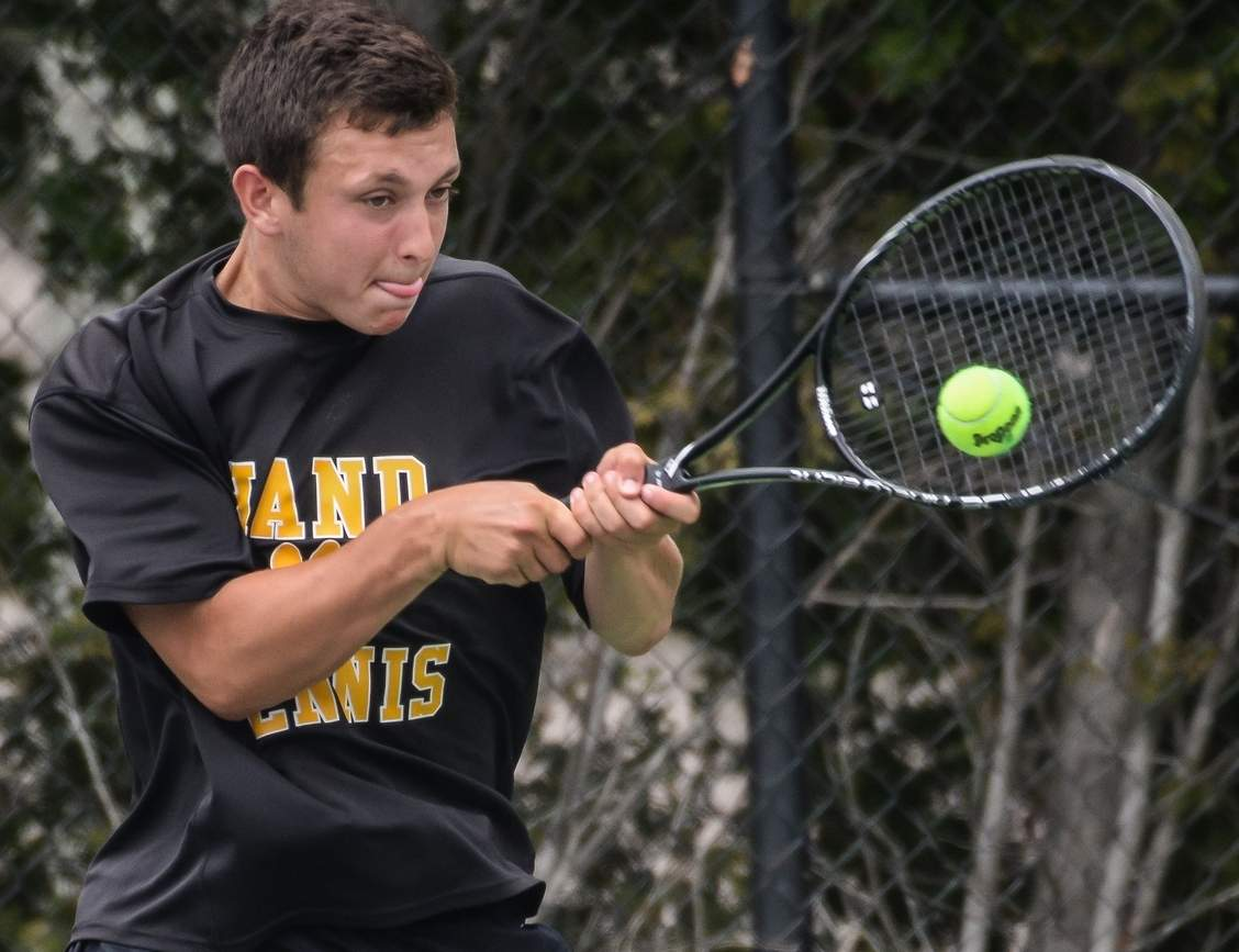 Senior co-captain Dan Weinreb has moved from doubles to singles this season for the Hand boys' tennis team, which is once again a top SCC and state title contender that's gotten out to a 12-0 start this spring.  Photo by Kelley Fryer/The Source