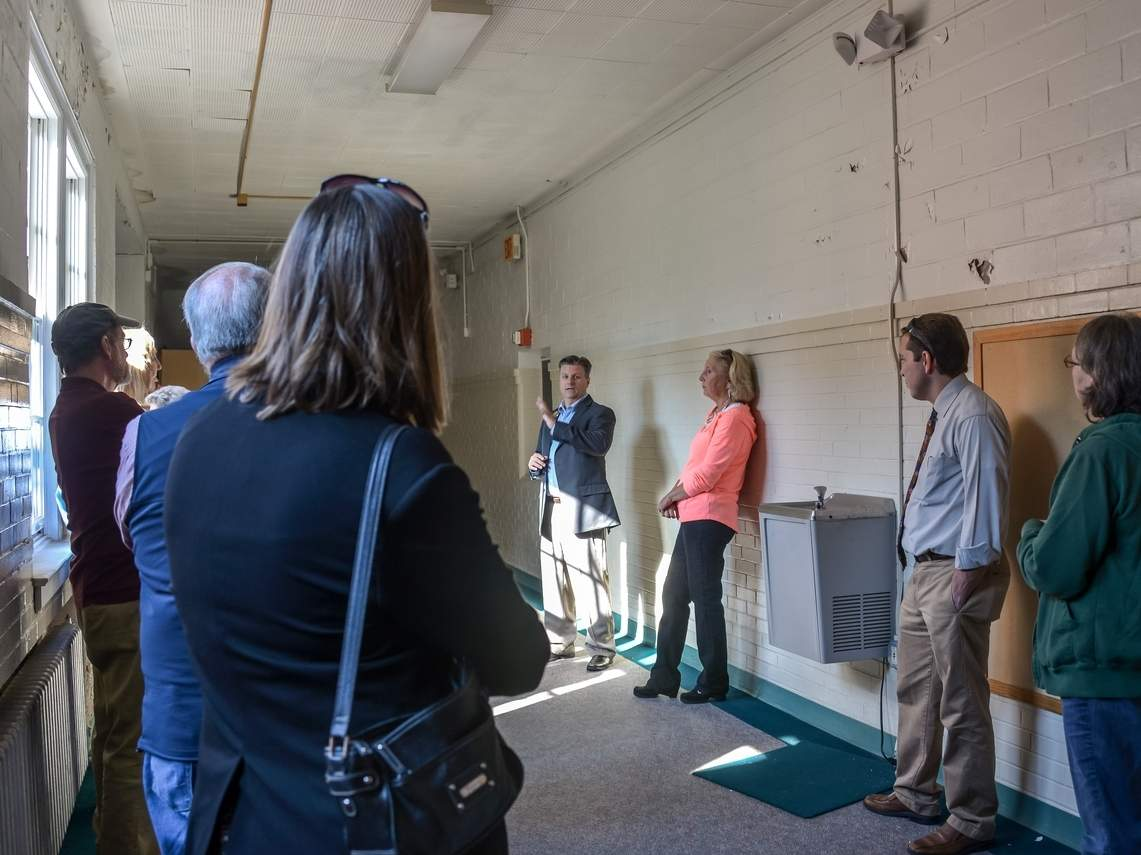 Shown here in 2014, Shoreline Arts Alliance Executive Director Eric Dillner led a tour of the Academy School building and shared the alliance's vision for creating a regional cultural arts center in Madison. The Board of Selectmen has chosen to not fund a further study on rehabilitating the building for use as an arts center and may consider proposals to sell the facility for use as condominiums. Photo by Kelley Fryer/The Source