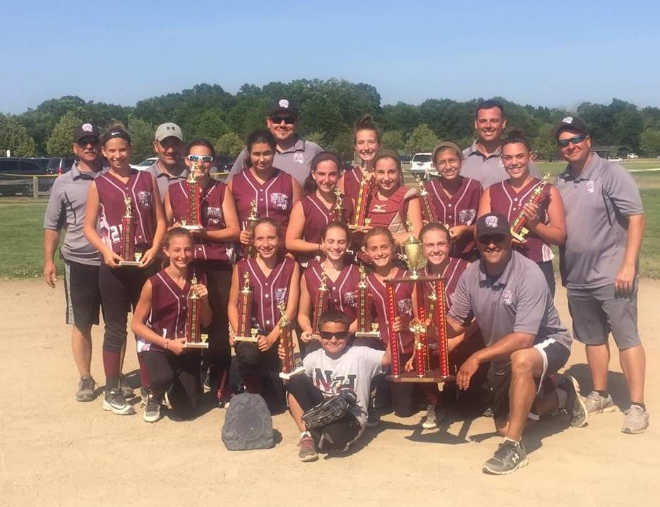 Pictured from the North Haven Pride 12-U softball team are (front row) Juliana DeAngelo, Taylor Quinn, Anna Schepisi, Caroline Toni, Lauren Fitzgerald, Head Coach Bobby Lockery, and bat boy Joshua Stefanik; along with (back row) assistant coach Jim Maenza, Megan Cross, assistant coach Brian Quinn, Jylian Esposito, Taylor Morris, assistant coach Frank Biceglia, Sydney Maenza, Kelsey McCarthy, Jordan Maenza, Olivia Stefanik, assistant coach Tony DeAngelo, Mariella Biceglia, and assistant coach Scott Stefanik.  Photo and information courtesy of Andrea Stefanik