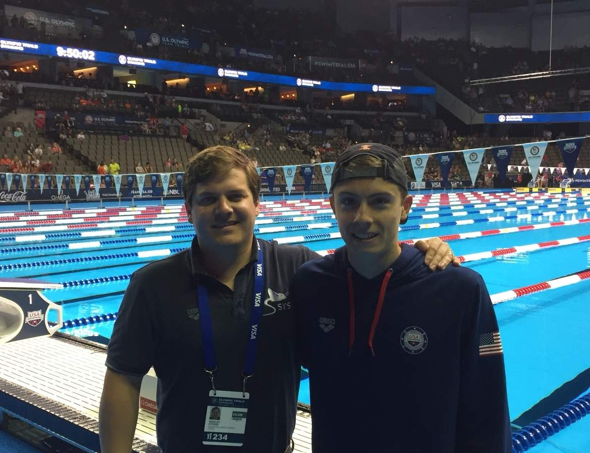 Guilford resident and Soundview YMCA Stingrays swimmer Corey Gambardella finished in 47th place with a time of 2:01.96 for the 200-meter butterfly at United States Olympic Team Trials in Men's Swimming in Omaha, Nebraska on June 28. Gambardella (right) is pictured with his Stingrays' coach Wesley Crozier.  Photo courtesy of Wesley Crozier