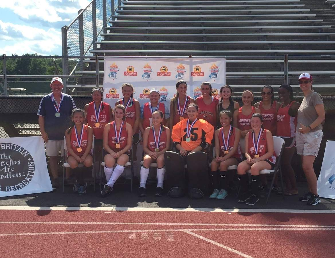 Branford field hockey claimed a gold medal by defeating Granby 4-0 in the tournament final at the Nutmeg Games. Pictured from the team are (back row) Coach Pete Frye, Brittany Bunbanlu, Carly Shea, Sabrina Torcellini, Brianna Shaw, Karly King, Gianna Messina, Molly Zaffino, Jessica Amarante, Mary Nwagboli, and Coach Ellenmary Frye; (front row) LanLe Crotty, Carol Frye, Alanna Grimm, Kierra Integlia, Leah Pendl-Robinson, and Caitlin Baker. Missing from the photo is Autumn McHenry  Photo and information courtesy of Pete Frye