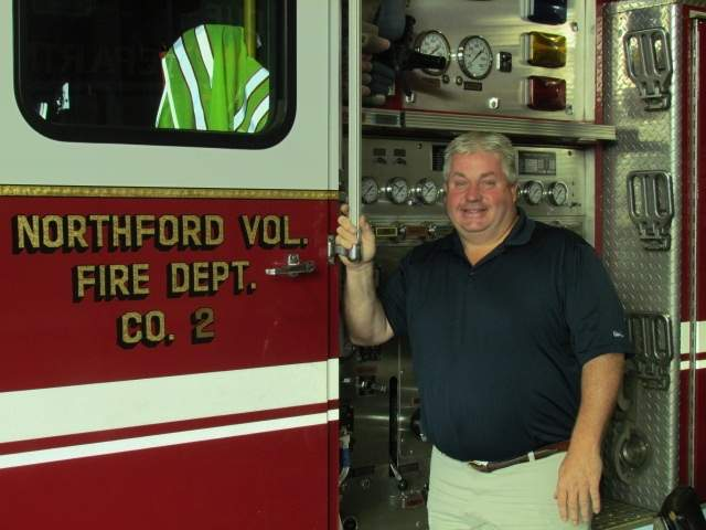 The grandson of a charter member, third generation volunteer firefighter Ken Neubig has been a member of Northford Volunteer Fire Company No. 2 for the past 33 years, and is one of just six captains in the department's six decades of service.  Photo by Pam Johnson/The Sound