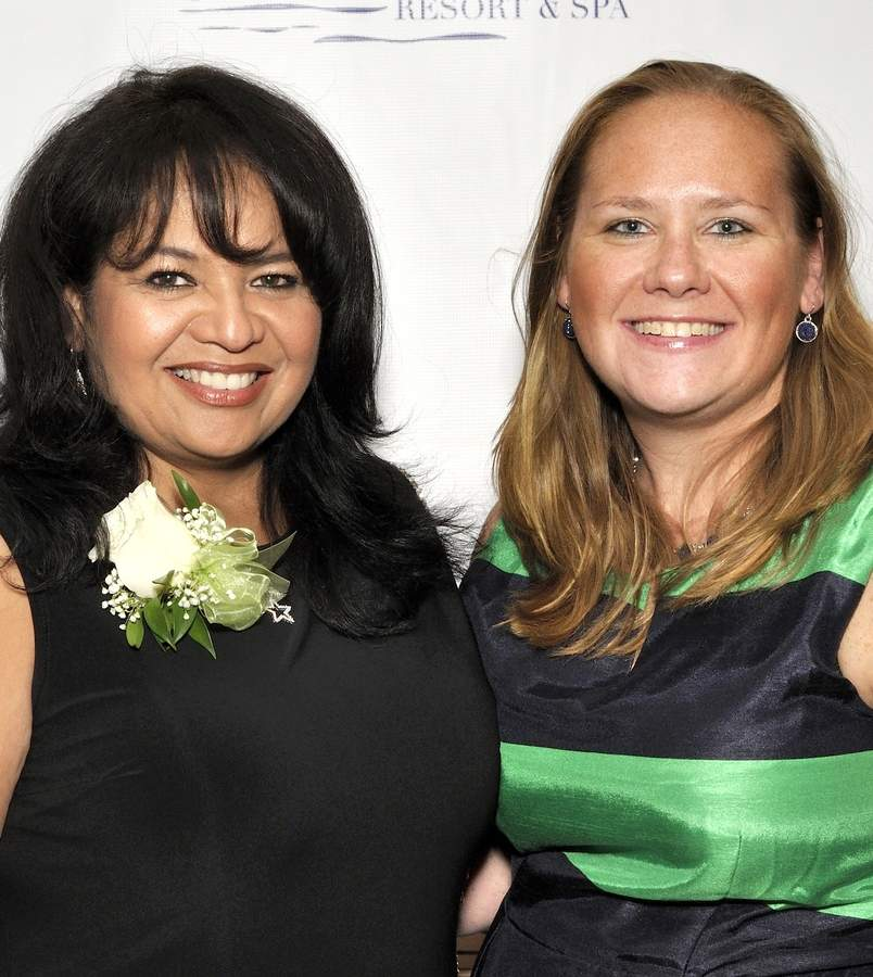 Jessica Demers, right, helped her friend Mari Lee (left) celebrate her 2016 Beacon Award last week. In two weeks, Jessica will share the spotlight—she was named Citizen of the Year by the Clinton Chamber of Commerce, which also awarded Lee with its Award of Distinction for Public Service. Photo by Julie Eckart Johnson/Harbor News