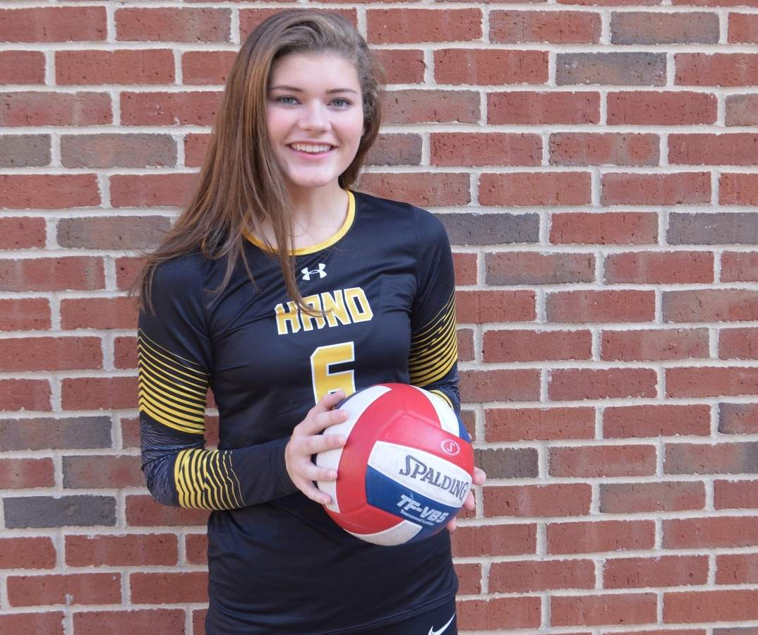 Senior right side hitter Maddy Pease never gives up on the floor with the Hand girls' volleyball squad and has produced in multiple stat columns for the Oronoque Division champion Tigers this year. Photo courtesy of Maddy Pease