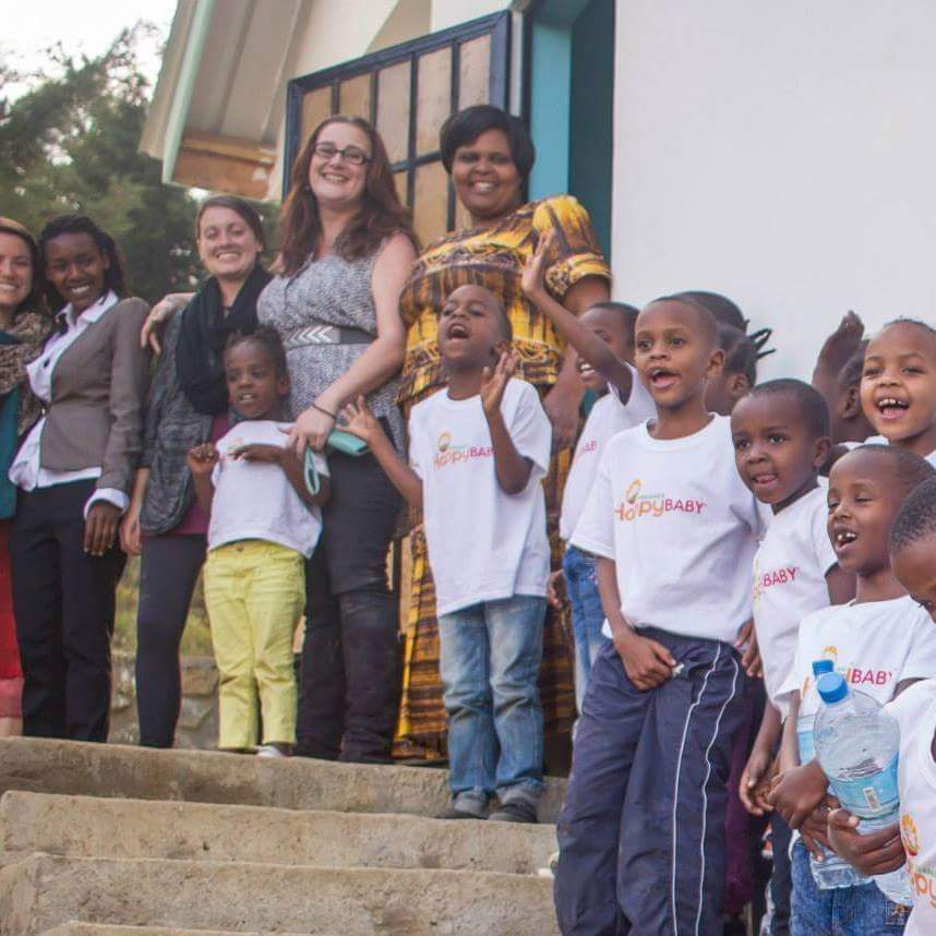 Bekka Ross Russell (fourth from left) founded The Small Things, a non-profit focused on ensuring happy, healthy, loving childhoods and access to opportunity for all children in the Arusha District community of Tanzania, Africa. Photo courtesy of Bekka Ross Russell
