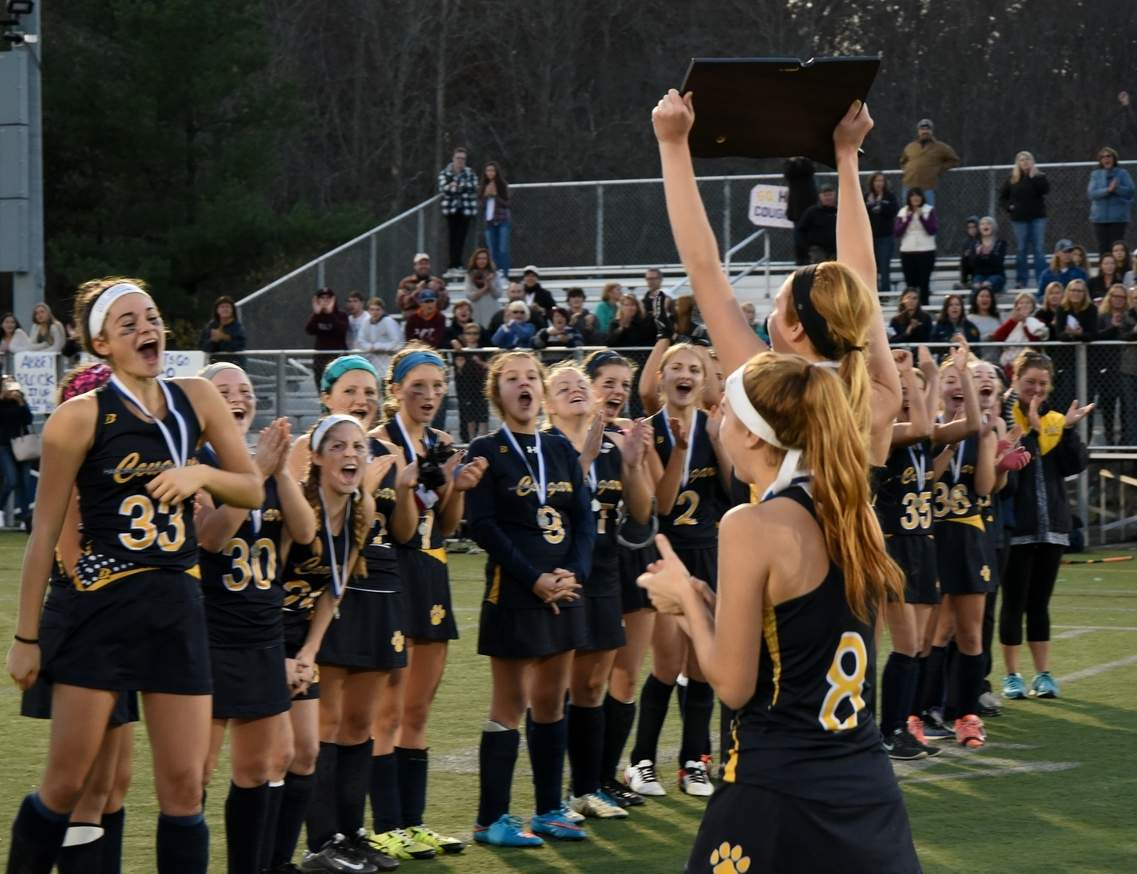 The HK field hockey team celebrates with its fourth state crown after sharing the Class S title with Westbrook following a 1-1 tie in the final. The Cougars finished the season with a record of 16-3-2.  Photo by Wesley Bunnell/The Source