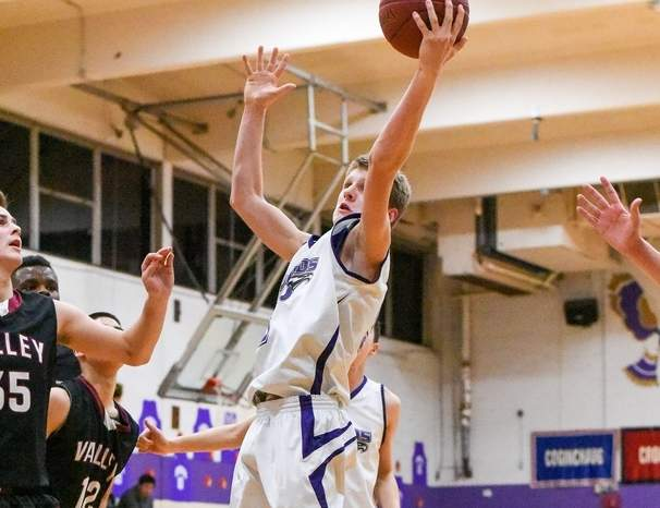 Brett Lequire's 19-point performance helped North Branford boys' hoops beat Hale-Ray by a 49-40 final in the team's first game of the season.   Photo by Wesley Bunnell/The Sound