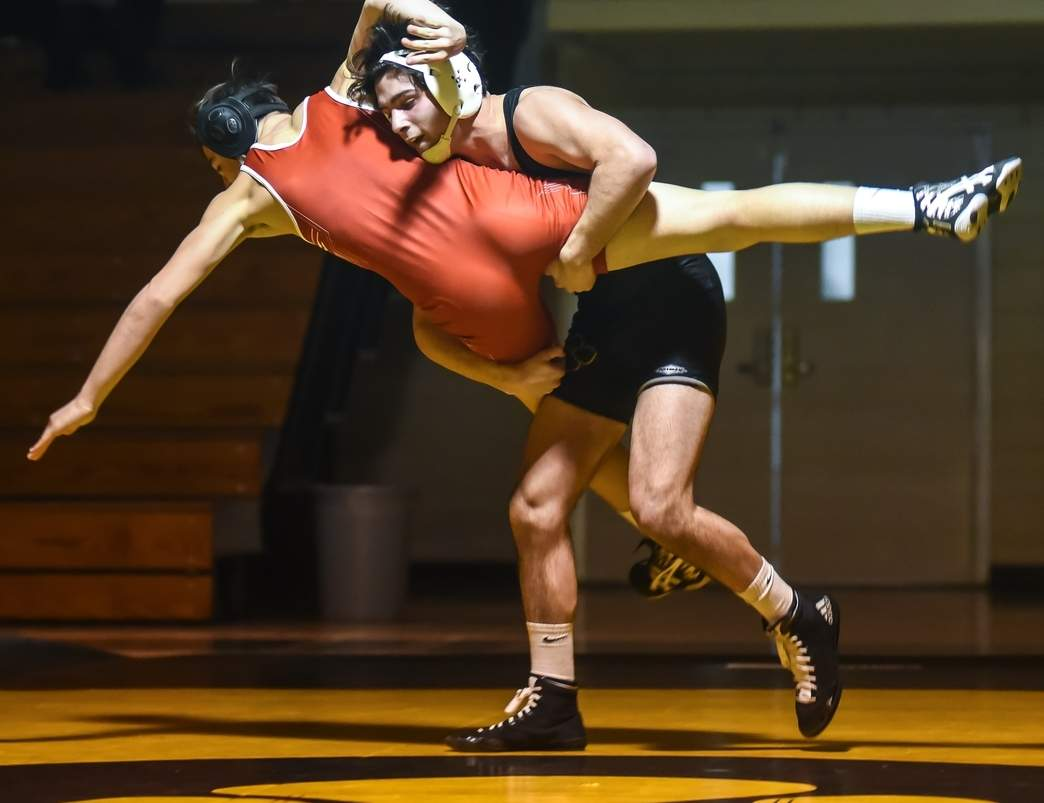 Zakery Santoemma scored a pinfall victory in his 152-pound contest as Hand wrestling defeated Fairfield Prep 48-21 to open the year on Dec. 14.   Photo by Kelley Fryer/The Source