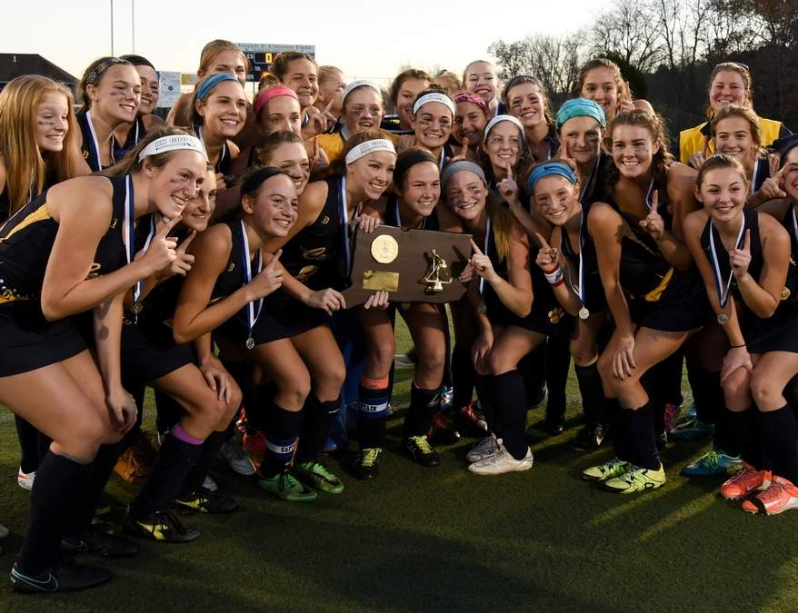 The Haddam-Killingworth field hockey team stands with the Class S state championship after its 1-1 tie with Westbrook in the final of the Class S State Tournament on Nov. 19.  Photo by Wesley Bunnell/The Source