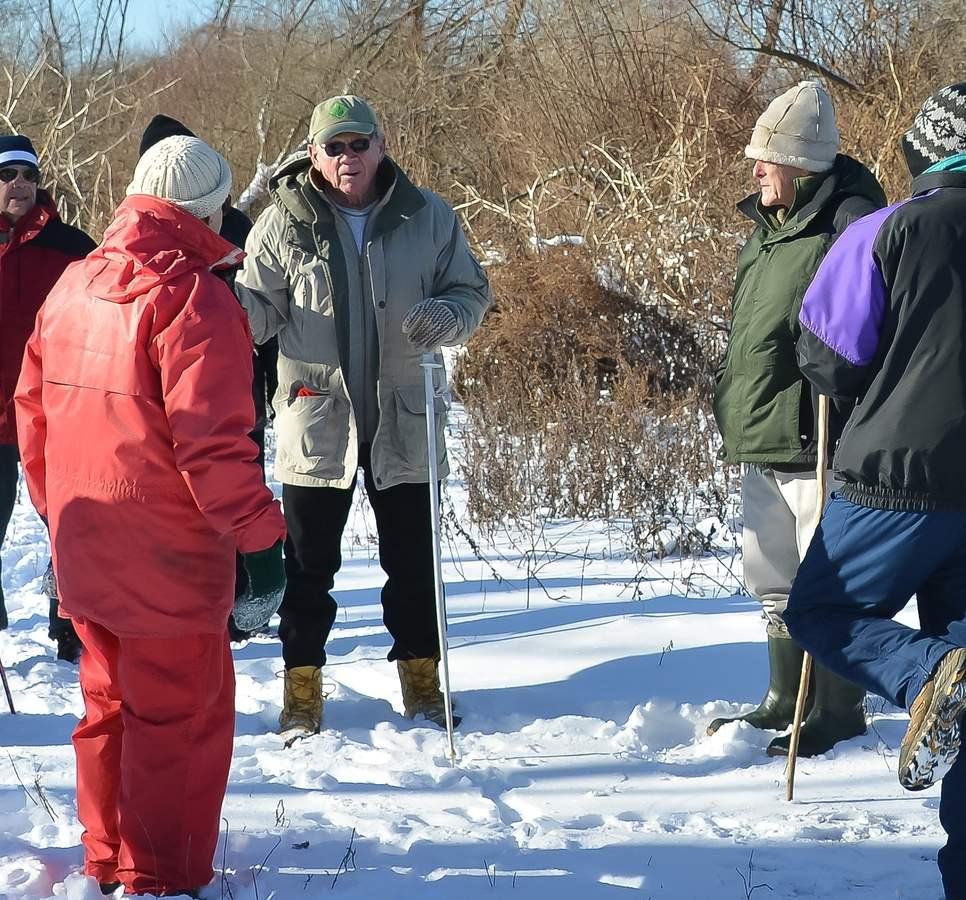 For many people in Branford, this is the way they envision Chet Blomquist: leading a hike on one of the town's many trails (this photo is from the Branford Shoreline Greenway Trail team second annual Chet Blomquist Post Christmas Winter Walk in 2014).   Photo by Kelley Fryer/The Sound