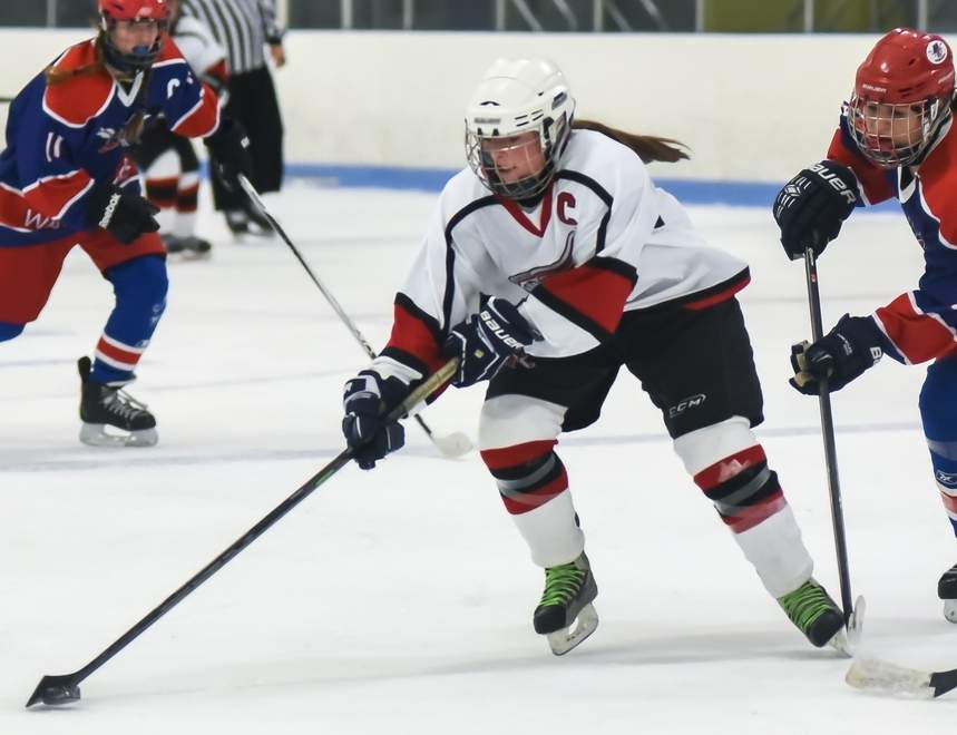 Senior captain Sydney Hogan and the Branford-East Haven-North Branford girls' ice hockey squad are now called the Wings this season. In last week's action, the Wings soared to a 7-1 win versus Guilford at DiLungo Rink on Jan. 12.   Photo by Kelley Fryer/The Sound