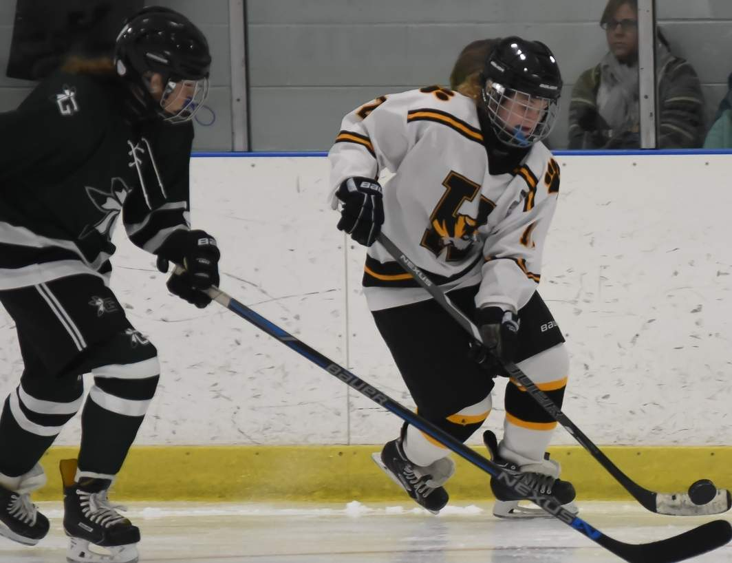 Sophomore forward Grace Lavin and the Hand girls' ice hockey team are looking to develop an even stronger offensive attack after putting together a stellar first half of the season. Photo by Kelley Fryer/The Source