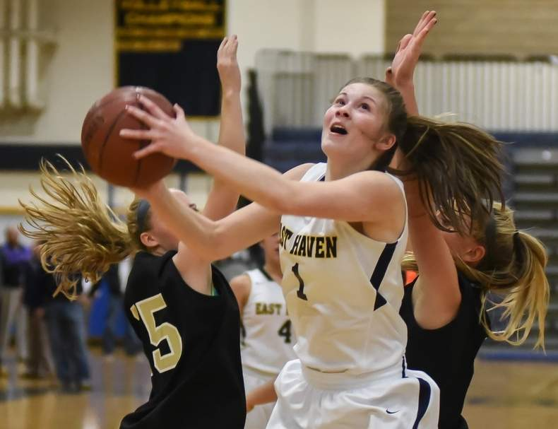 A few days after her team clinched a share of the Quinnipiac Division title, junior Kylie Schlottman hit the 1,000-point plateau for the East Haven girls' basketball squad on Feb. 3. Photo by Kelley Fryer/The Courier