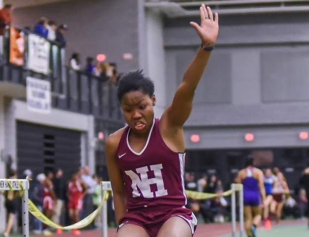 Sophomore Erica Marriott won the long jump with a distance of 16 feet-2.75 inches to help the North Haven girls' indoor track team claim third place at the Class L State Championship. Photo by Kelley Fryer/The Courier