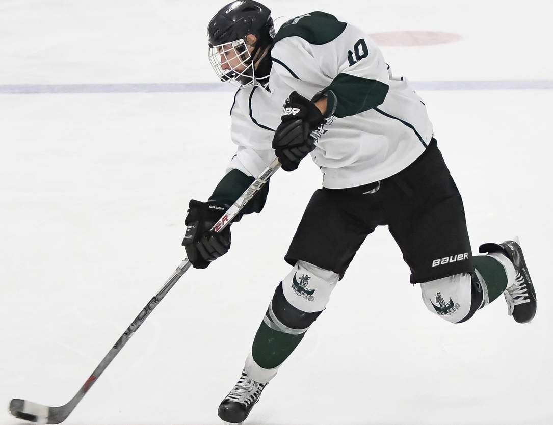 Sophomore John Delucia recently reached the 100-point mark for his career with the Guilford boys' ice hockey team, which beat Trinity Catholic and North Haven last week to up its mark to 14-3. Photo by Kelley Fryer/The Courier