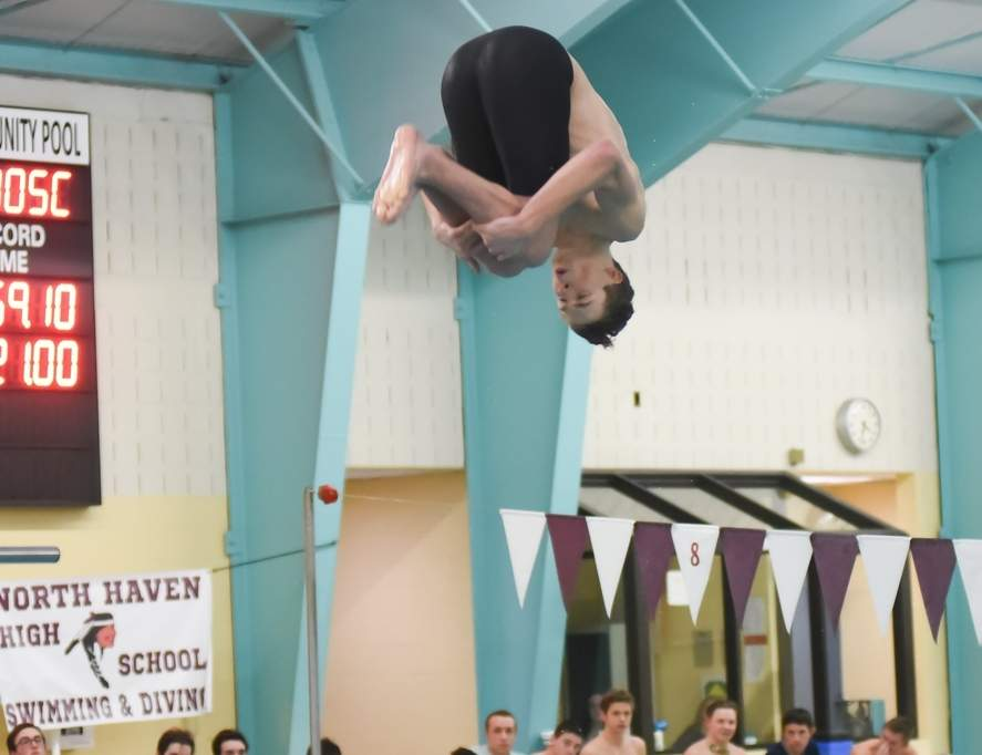 Senior Kyle Duby scored a 256.85 in the diving competition for the Indians last week to break a school record that had stood for four decades. Photo by Kelley Fryer/The Courier