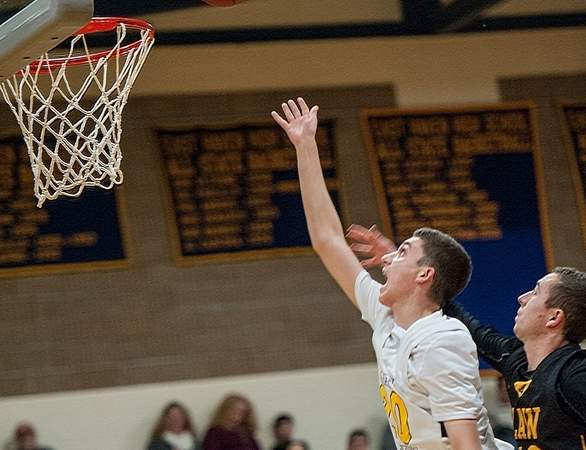 Junior Ed Popolizio and the East Haven boys' basketball team posted their third victory of the season by prevailing at Platt Tech 63-48 last week. Photo by Susan Lambert/The Courier