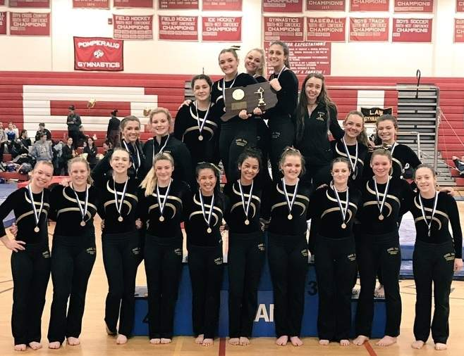 The Hand gymnastics squad scored 137.3 points to earn its fifth straight Class M state crown on Feb. 25 at Pomperaug High School. This marks the first time the Tigers have won five state titles in a row and they've now prevailed at states 18 times in the program's history. Photo courtesy of Kelly Smith