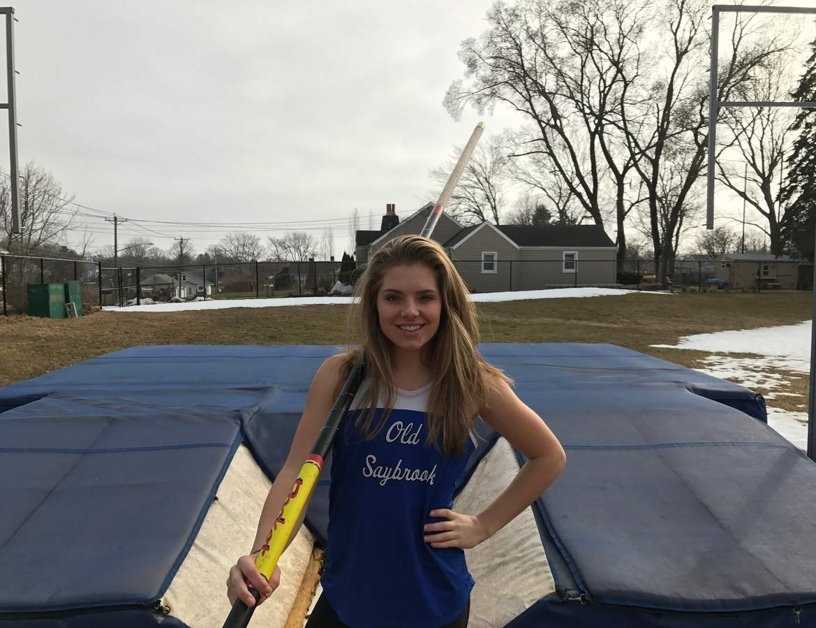 After running on two triumphant relay teams while helping Old Saybrook girls' indoor track win the Shoreline Conference title, junior captain Tyra Finkeldey took first place in the pole vault by clearing 10 feet-6 inches at Class S State Championship. Photo courtesy of Tyra Finkeldey
