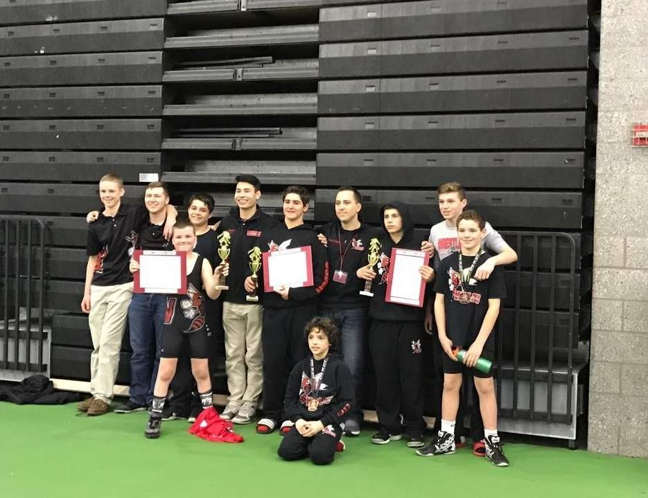 Branford Youth Wrestling coaches and wrestlers celebrate a solid end to the season at states, including (back row) Coach Max Warner, Coach Nick Kelsey, AJ Robinson, Coach Tony Le, Justin Osler, Coach Tom Ermini, Gianni Liguori, Spencer Lyon, and TJ Shields; along with (front row) Dylan Warner and Jake Elpi. Photo courtesy of Maureen Shields