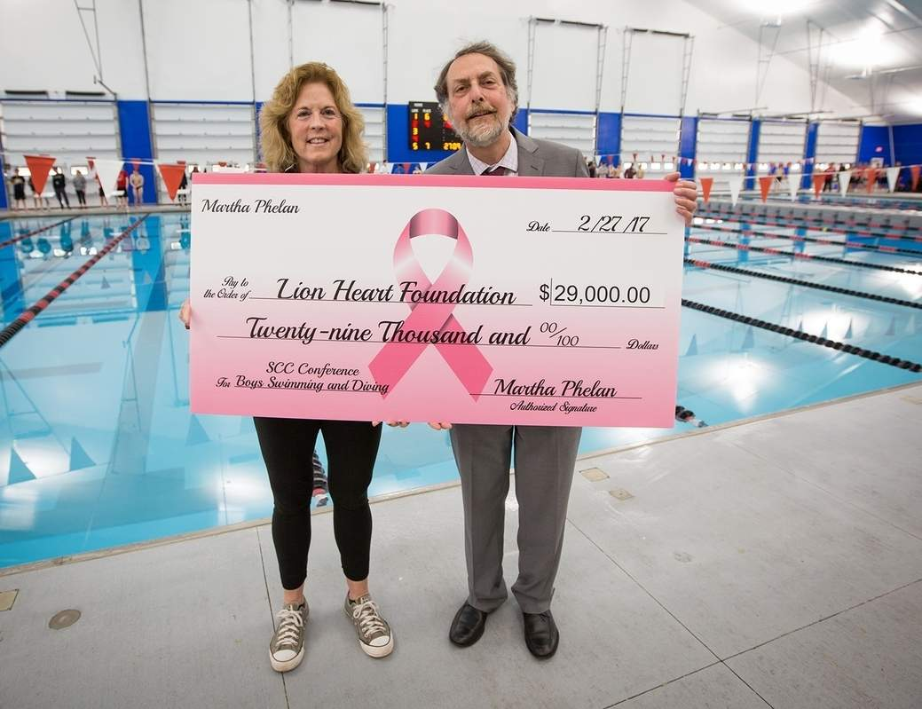 North Haven boys' swimming and diving Head Coach Martha Phelan with Dr. David Stern from the Yale Cancer Hospital. Photo courtesy of Chris Powell