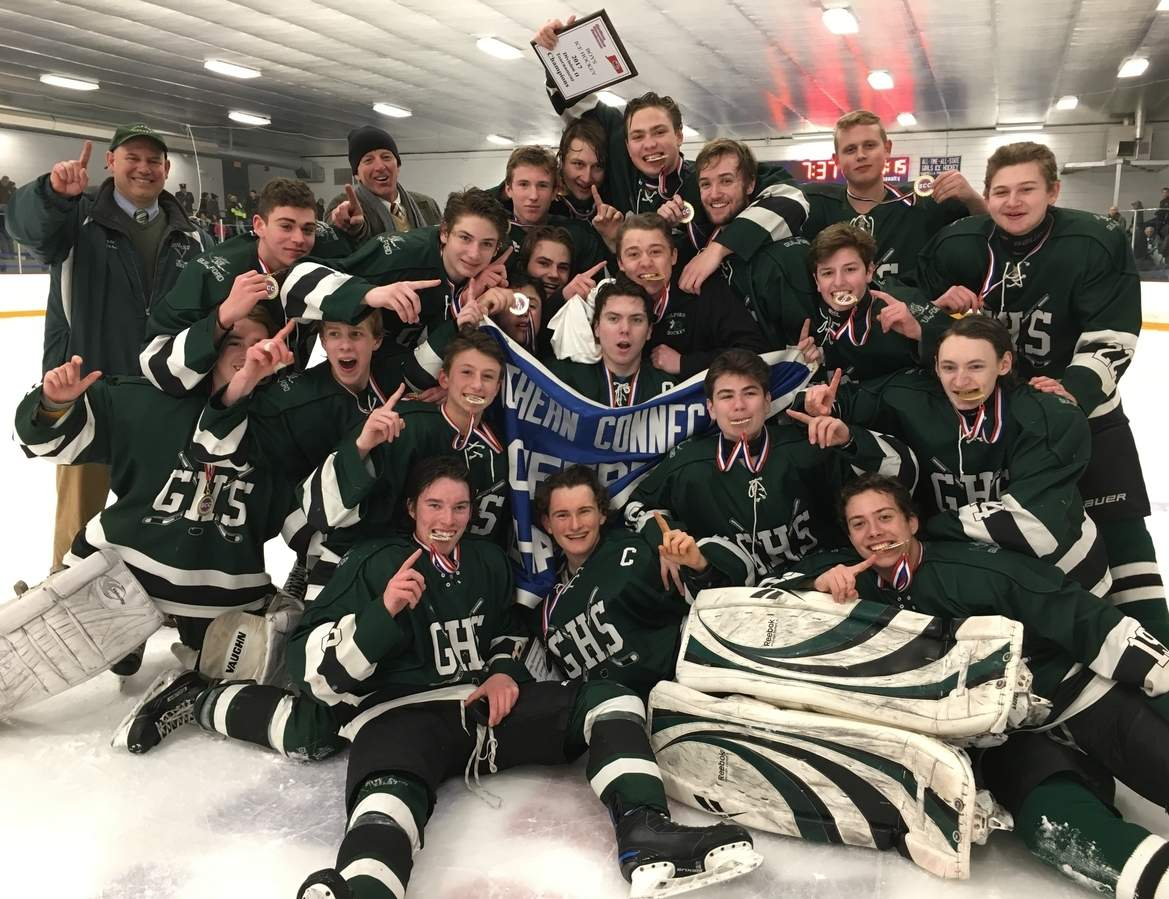 The Guilford boys' ice hockey team celebrates its first conference title after a claiming a 3-2 overtime win against East Haven in the SCC/SWC Division II Tournament final at Bennett Rink in West Haven on March 4. Photo courtesy of Al Carbone