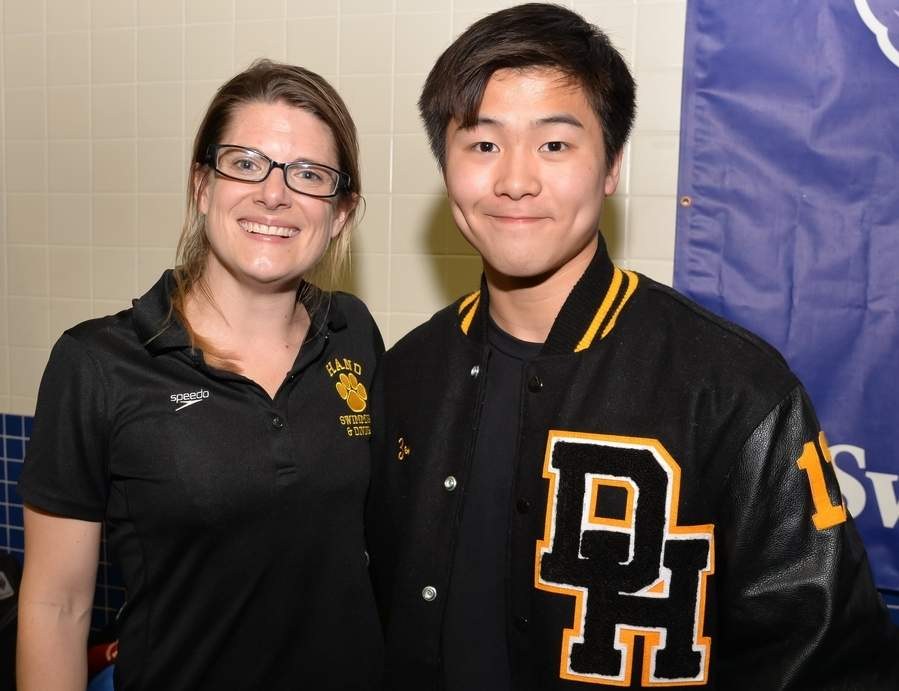 Hand boys' swimming and diving Head Coach Christina Forristall was named the SCC Coach of the Year and Teddy Zeng broke the SCC Diving Championship record on his way to his fourth straight title. The Tigers finished third at the SCC Championship, marking the program's best finish in the meet. Photo by Kelley Fryer/The Source