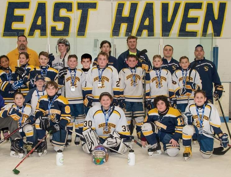 Pictured from the East Haven Squirt B ice hockey squad are (back row) assistant coach Tom LaCroix; Mani Finoia, who helped out the team with some of his fellow high school players; high school player Ryan Albert, assistant coach Alan Robert, assistant coach Joe D'Albero, and Head Coach Bill Demetriades; (middle row) Cheyene Wilson, Sarah Johnson, Leo Ferranti, TJ Reddington, Robert Testa, John D'Albero, Josh Salvati, Cameron LaCroix, and Chase DeFilippo; (front row) high school player Logan Hamilton, Billy Demetriades, water boy Mason LaCroix, Dilan Robert, Belle Desrosiers, Joey Vocatura, Nick Perillo, and high school player Joe Consiglio. Photo courtesy of Michele D'Albero