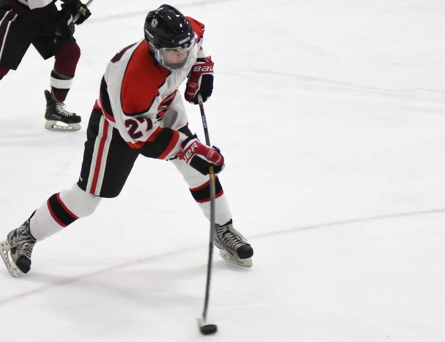 Senior Mitchell Petrillo's natural hat trick helped the Branford boys' ice hockey squad earn a 3-1 win versus Westhill-Stamford in a Division II State Tournament contest. The Hornets later lost to Watertown-Pomperaug to finish the year with a record of 12-9-1. Photo by Kelley Fryer/The Sound