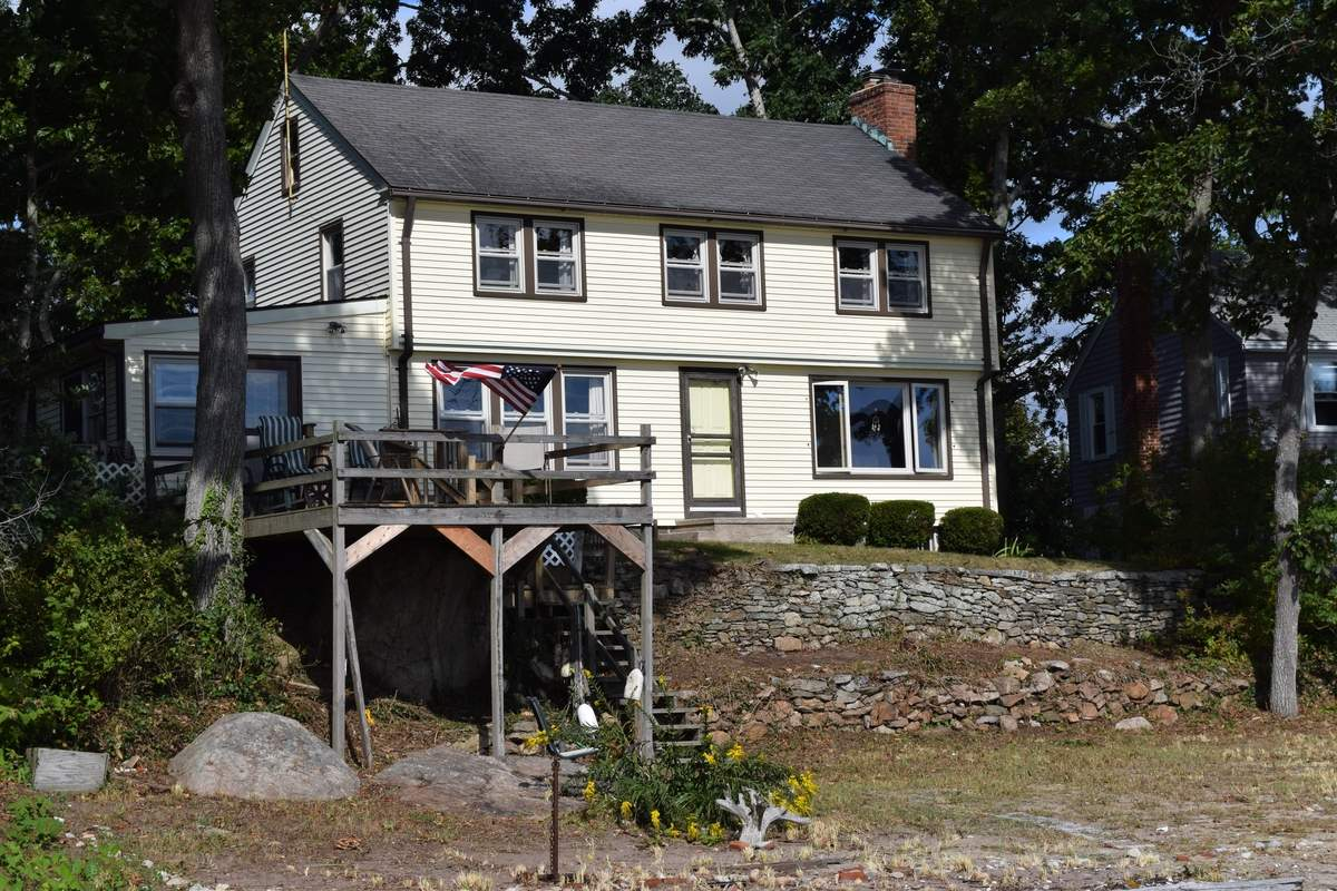 High and dry in Clinton, this four-bedroom Colonial offers great views of the Sound.