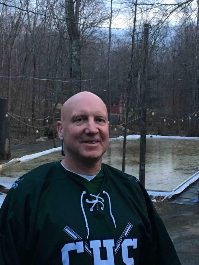 A father of two Guilford ice hockey players, Scott Neleber became an important piece of the girls' team when he joined the Indians as a volunteer assistant coach this winter.  Photo courtesy of Pam Neleber