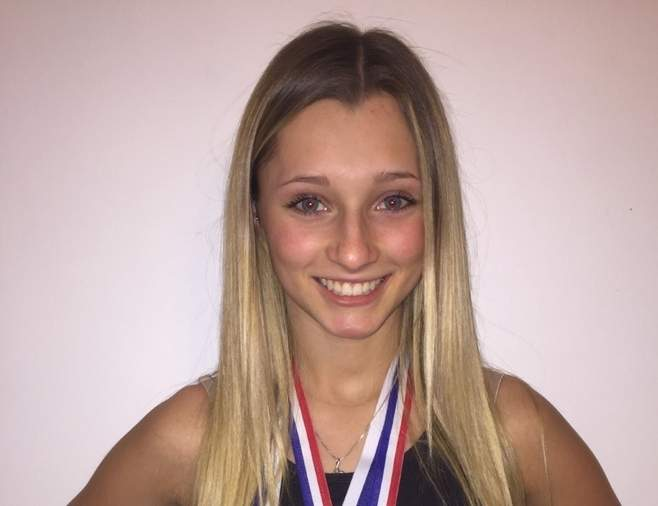Senior captain Jordyn Aurora earned All-Conference and All-State honors while helping the North Haven cheerleading team win its first SCC title in the Co-ed Division this winter. Jordyn will be competing for the girls' lacrosse team in the spring.  Photo courtesy of Jordyn Aurora