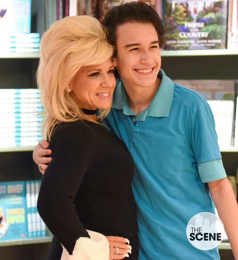 Theresa Caputo drew crowds of fans to R.J. Julia's on Thursday night for a book signing and photo op. Justin Gonzelez gets a photo with Theresa.