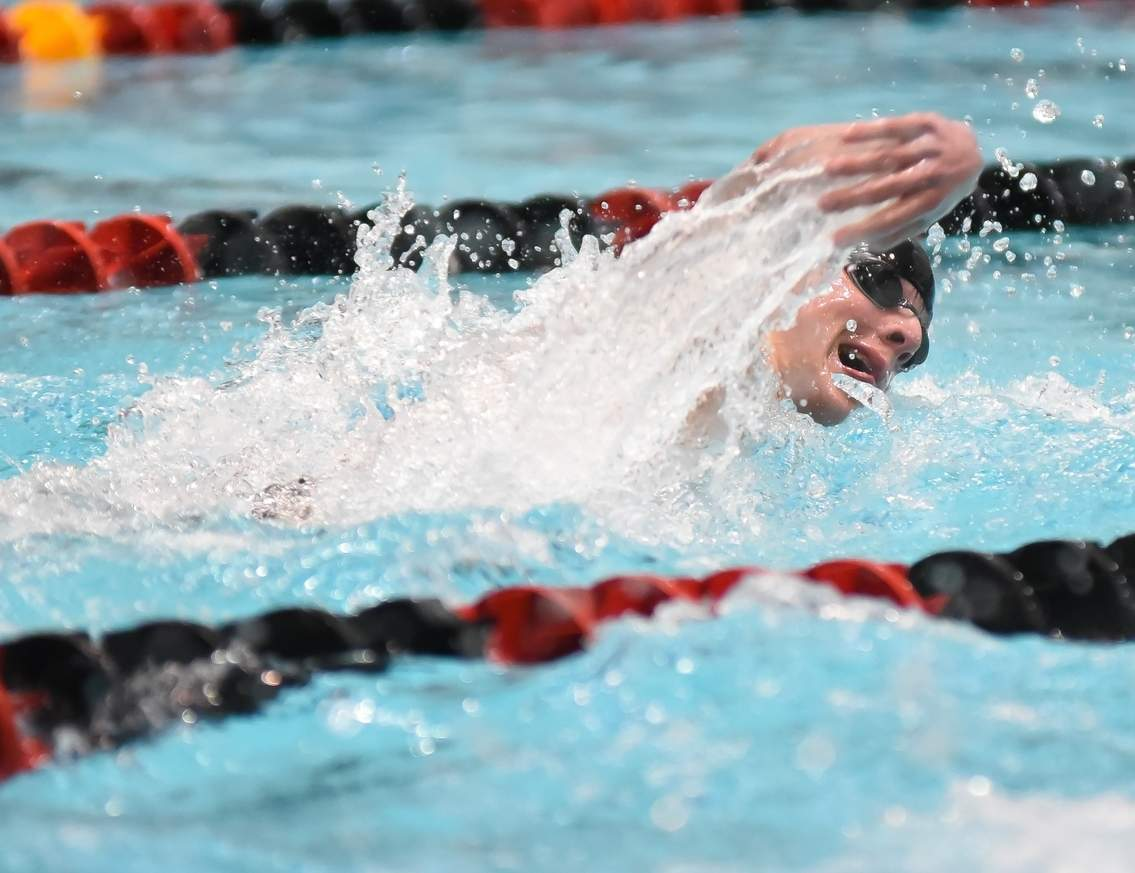Old Saybrook's Mac Coppes took first place in the 50 freestyle (21.99 seconds) and the 100 freestyle (49.43) with personal-best times in both events at the Class S State Championship at Wesleyan University on March 16. Photo by Kelley Fryer/Harbor News