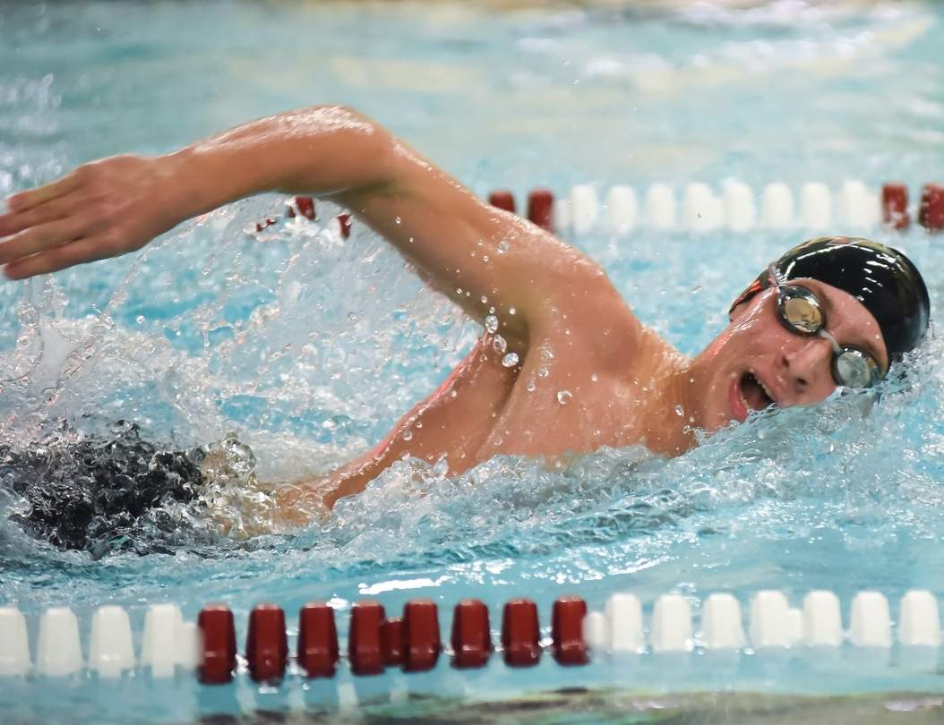 Sophomore JP Stoeffler finished 18th in the 50 freestyle with a time of 23.55 seconds for North Haven at the Class M State Championship. Photo by Kelley Fryer/The Courier