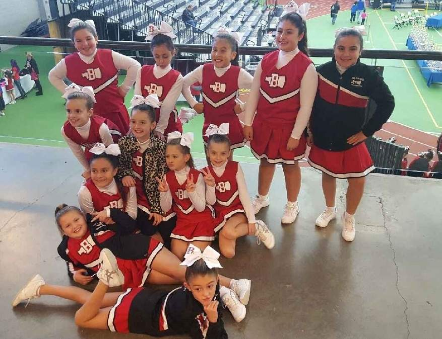 The Branford Youth Cheerleading program is looking for donations to buy new uniforms for its four squads. Pictured is Branford's 4th-grade Youth Cheer team from the 2016 season. Photo courtesy of Judith Barron