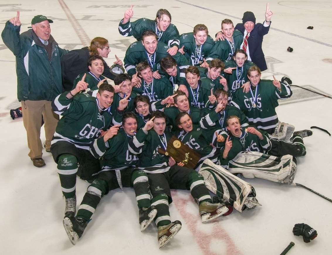 The Guilford boys' ice hockey team celebrates with the Division II State Tournament title after beating Watertown-Pomperaug 5-3 in the championship game at Ingalls Rink on March 18. Photo by Wesley Bunnell/The Courier