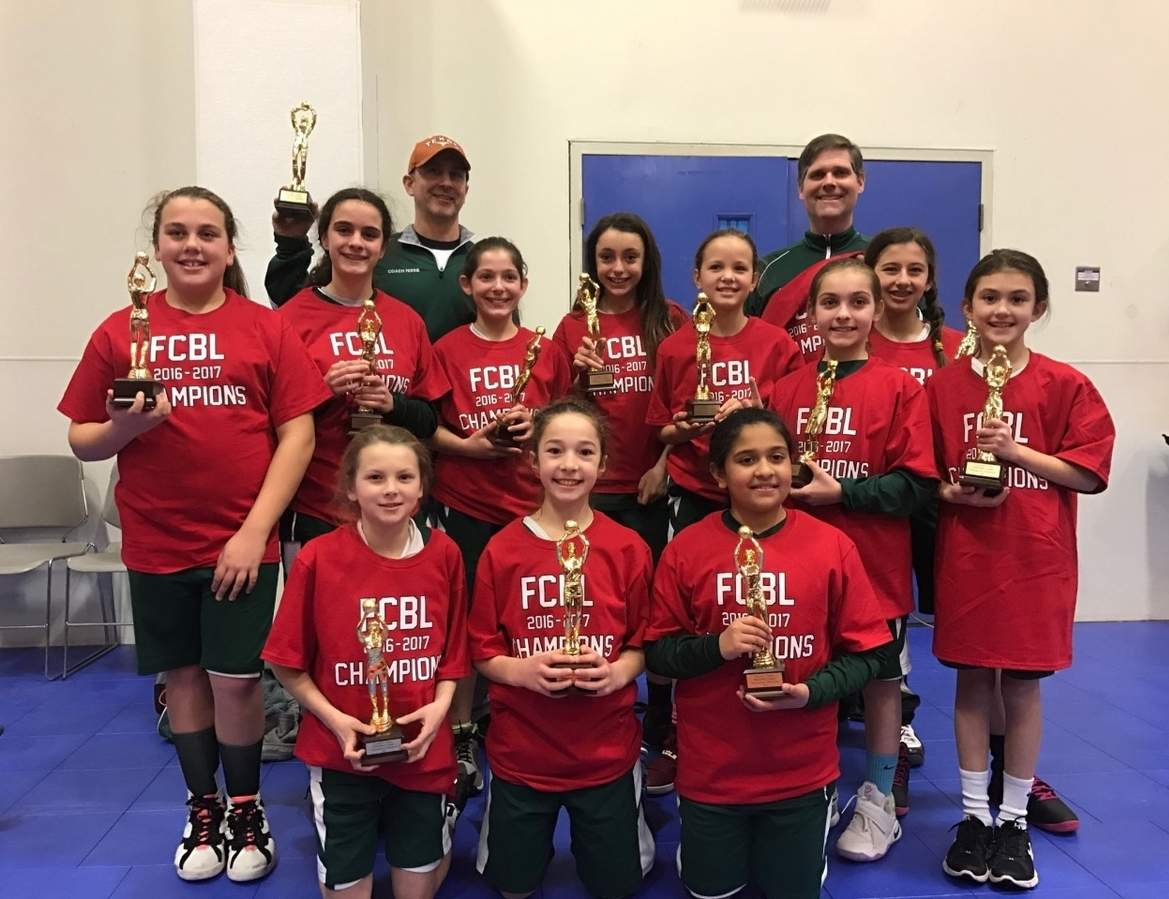 Pictured from Guilford's 5th-grade girls' travel basketball squad are (top left) Coach Fred Ferrie and (top right) Coach Dave Meade; along with (back row) Addie Smith, Maria Gregory, Lyndsey Vale, Carly Feldman, Alex Matthews, Sophia Meade, Taylor Barberio, and Faith Ferrie; plus (back row) Hallie Yerkis, Payton Root, and Saachi Mehta. Missing from the photo is Hanna Jennings. Photo and information courtesy of Fred Ferrie